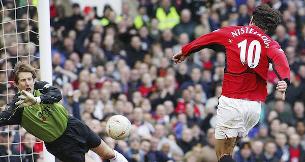 MANCHESTER, ENGLAND - MARCH 6: Ruud van Nistelrooy of Manchester United scores United's second goal during the AXA FA Cup match between Manchester United and Fulham at Old Trafford on March 6, 2004 in Manchester, England. (Photo by Tom Purslow/Manchester United via Getty Images)