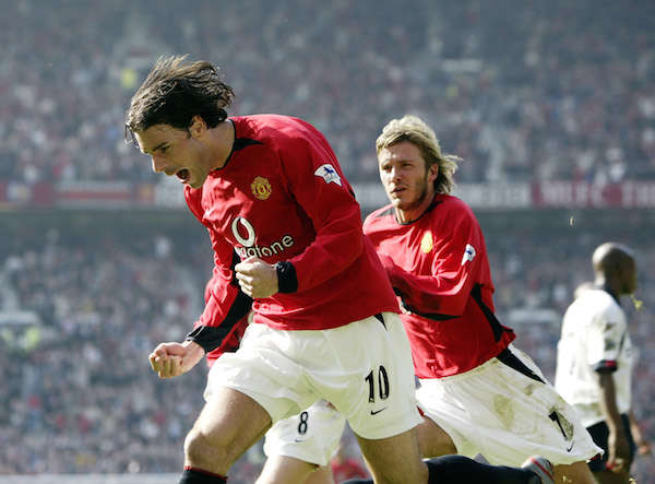 MANCHESTER - MARCH 22: Ruud van Nistelrooy of Manchester United celebrates scoring with team-mate David Beckham during the FA Barclaycard Premiership match between Manchester United and Fulham held on March 22, 2003 at Old Trafford, in Manchester, England. Manchester United won the match 3-0. (Photo by Alex Livesey/Getty Images)