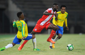 Fortune Makaringe challenged by Teko Modise and Percy Tau
