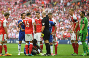 Victor Moses show a red card for diving