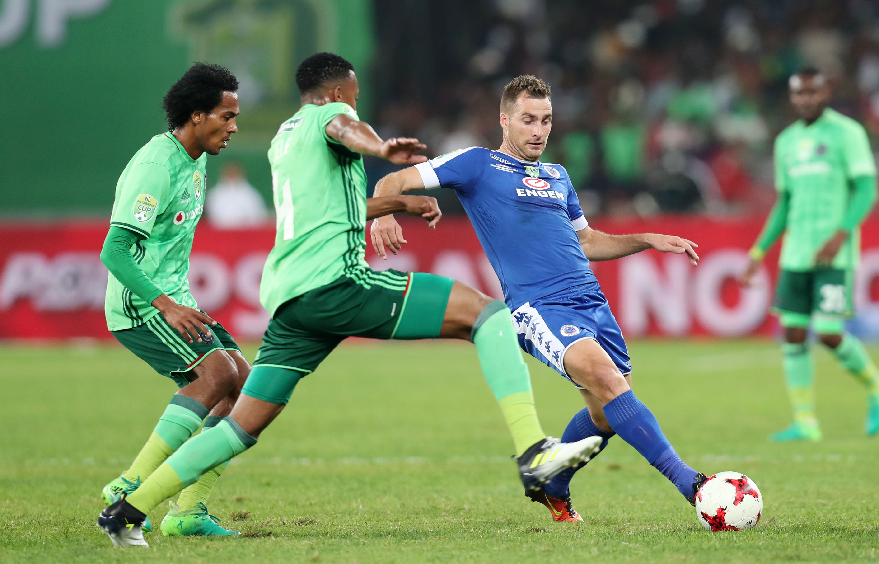 Bradley Grobler of challenged by Happy Jele