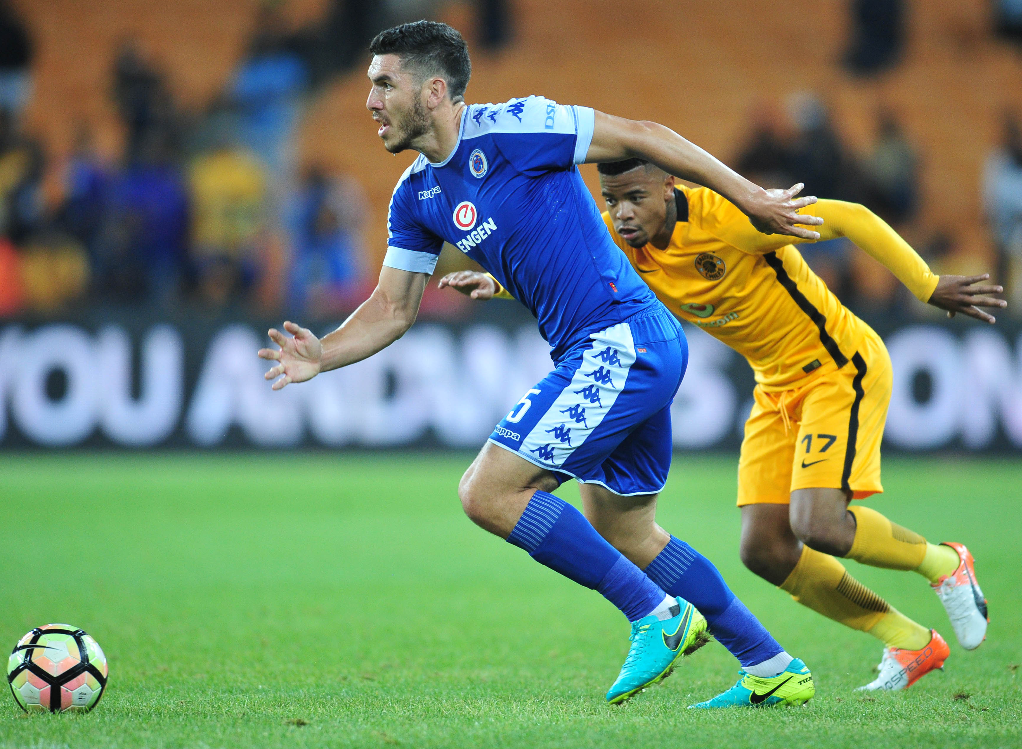 Michael Boxall challenged by George Lebese