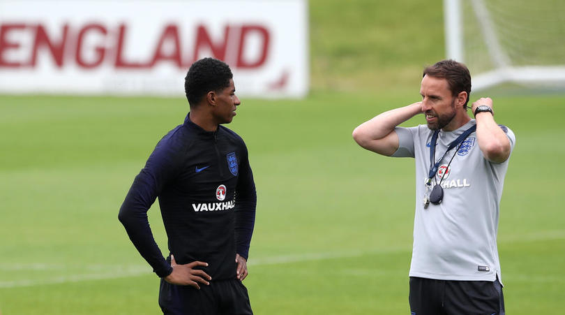 England manager Gareth Southgate speaks to Marcus Rashford during a training session at St George's Park, Burton.