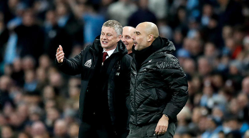 Manchester United manager Ole Gunnar Solskjaer (left) and Manchester City manager Pep Guardiola (right) enjoy a laugh on the touchline during the Premier League match at the Etihad Stadium, Manchester.