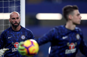 Chelsea goalkeeper Willy Caballero looks on at goalkeeper Kepa Arrizabalaga during the warm up before the Premier League match at Stamford Bridge, London.