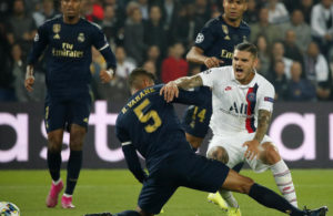 PSG's Mauro Icardi, right, is tackled by Real Madrid's Raphael Varane during a Champions League match