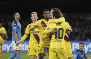 Barcelona's Antoine Griezmann, right, is hugged by teammate Barcelona's Lionel Messi after scoring in the Champions League