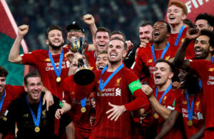 Liverpool's Jordan Henderson celebrates with the trophy after the FIFA Club World Cup final at the Khalifa International Stadium, Doha.