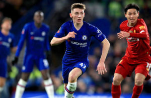 Chelsea's Billy Gilmour controls the ball away from Liverpool's Takumi Minamino (right) during the FA Cup fifth round match at Stamford Bridge, London.